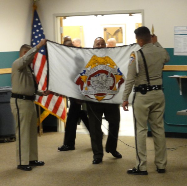 Sheriff's Department preps their flags.JPEG