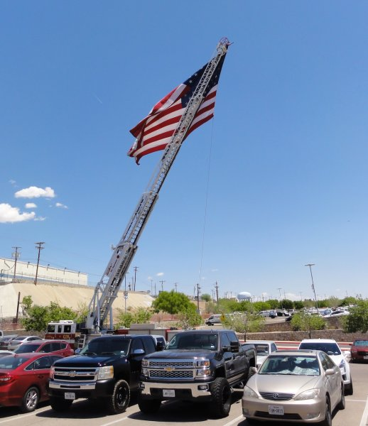 EPFD sets up large flag in EOCC parking lot.JPEG
