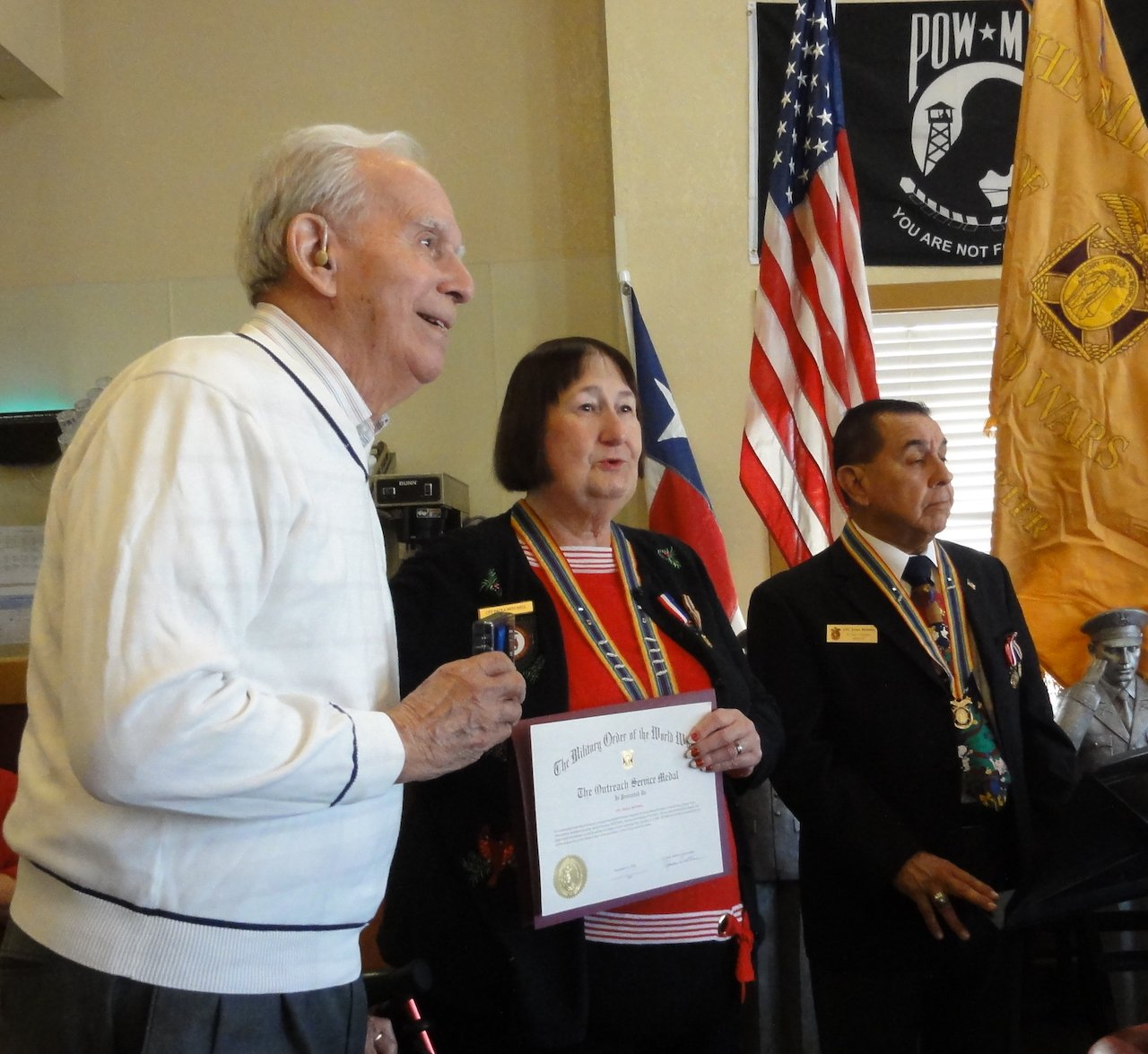 Col Raul Garibay Receives the Outreach Service Medal.JPG