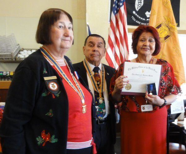 Chapter Chapln Laura Beltran Receives the Outreach Service Medal.JPG