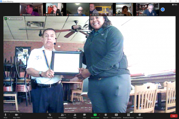 Cmdr Betran presents a Certificate of Appreciation to Tess English, BSA Field Director.png