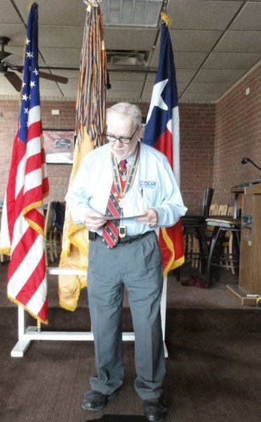 Sr Vice David Thackson reads the names of honorees.JPG