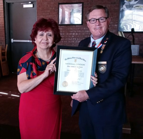 Laura Beltran presented with her National Citation by LTC Pat Stolze.jpeg