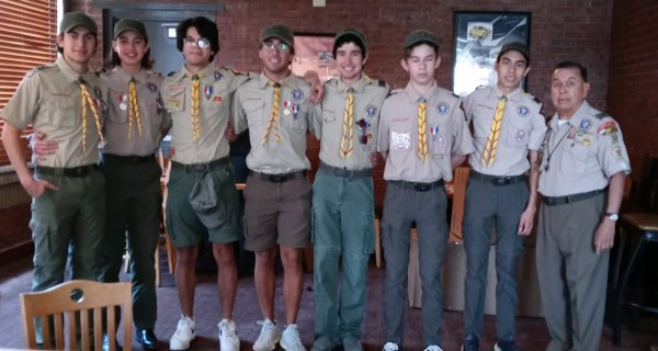 All 7 Eagle Scout Honorees with Chapter Chair LTC Beltran.jpeg