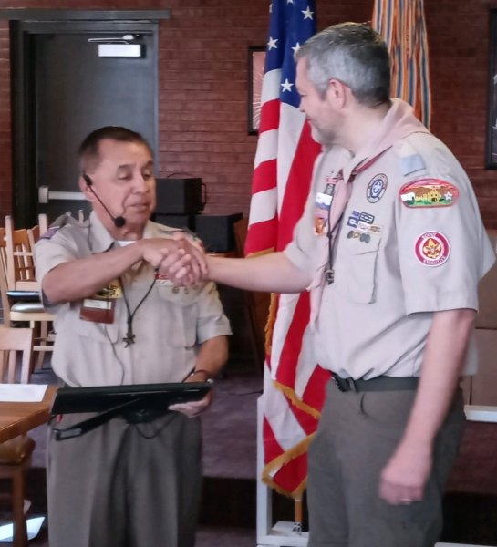 LTC Jesus Beltran presents a Certificate of Appreciation to Scout Executive Ty Page.jpeg